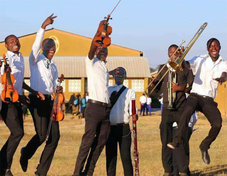 Zambia-string-players-jump.jpg